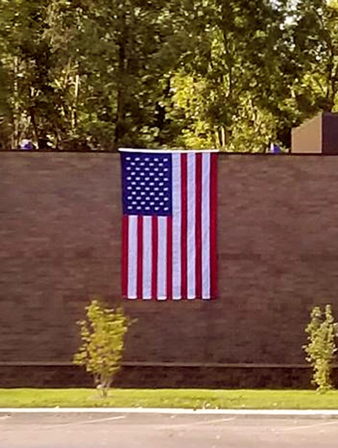 Huron Valley Guns - US Flag on Building